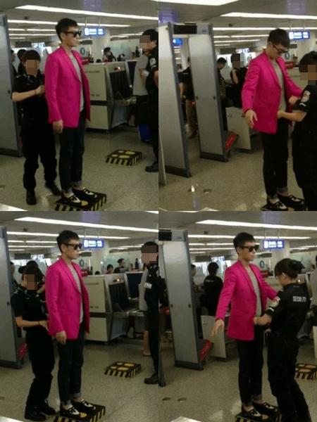 的是演艺界时尚明星喜爱的hot粉色外套,站在检查台上.接受女检查
